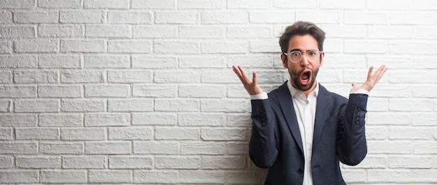 Young friendly business man crazy and desperate, screaming out of control