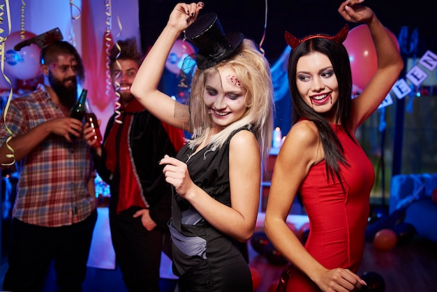 Young friends having fun at halloween party