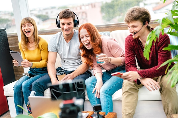Young friends influencer having fun on streaming platform with web cam