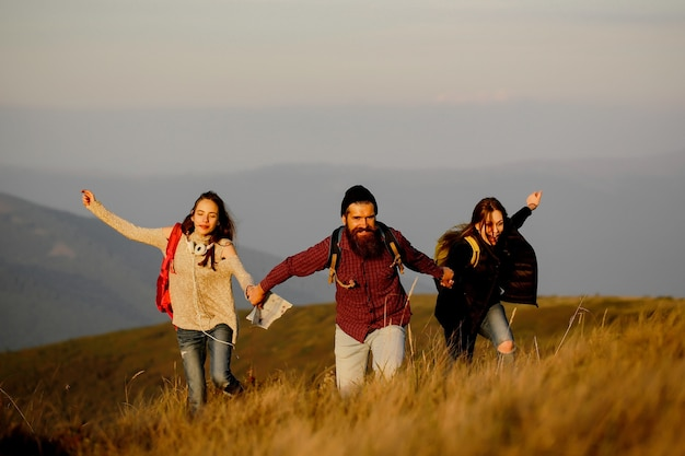 Young friends run on mountain