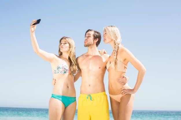 Young friends taking a selfie on the beach