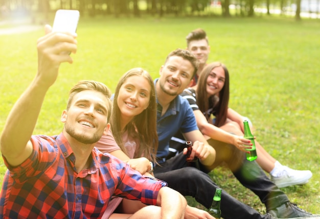 Young friends taking selfie during barbecue picnic.