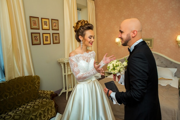 Young funny just merried couple at home