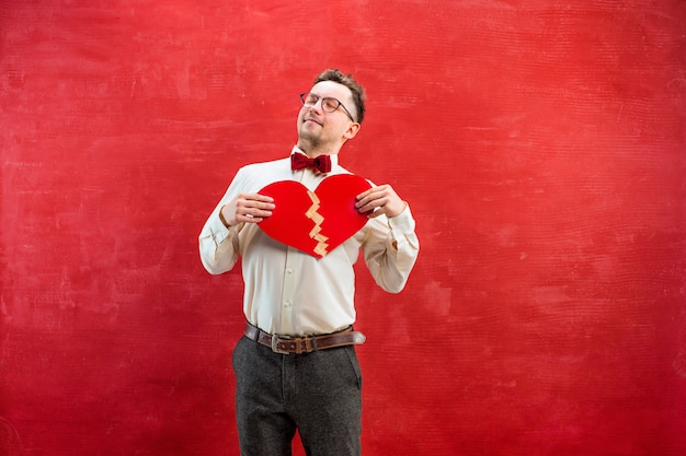 Young funny man with abstract broken heart