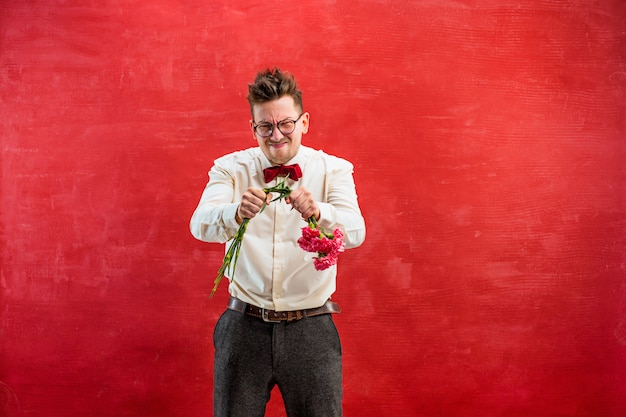 Young funny man with broken bouquet