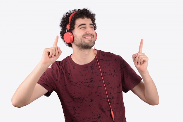 Young funny man with headphones