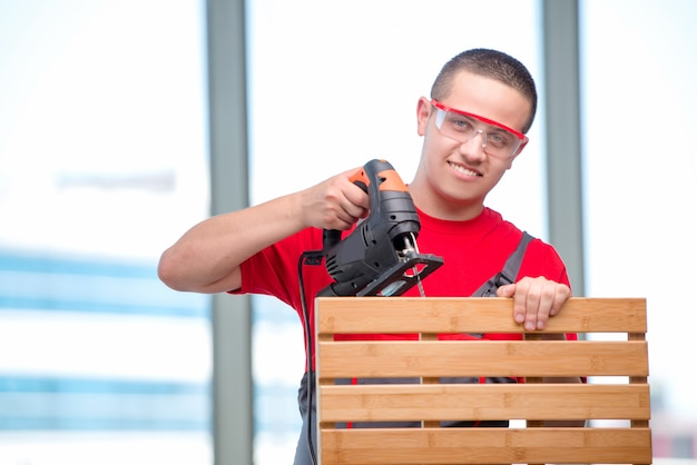 Young furniture carpenter in industrial