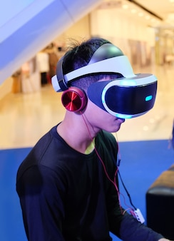 Young gamer with a headset playing the game.