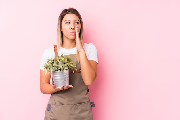 Young gardener woman is saying a secret hot braking news and looking aside