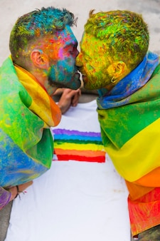 Young gays kissing on holi festival
