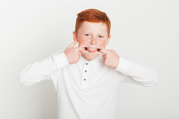 Young ginger boy fooling around