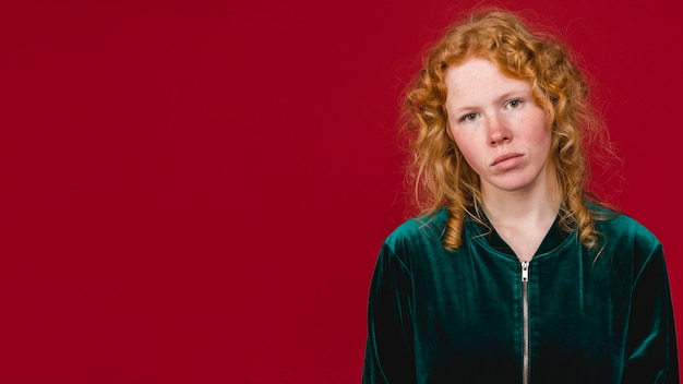 Young ginger calm woman looking at camera