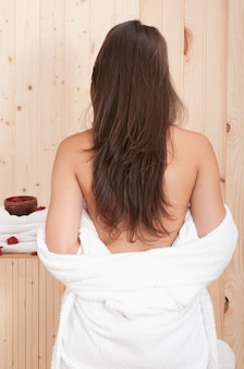 Young girl in bathrobe after spa treatment