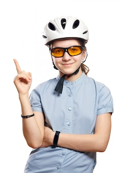 Young girl in bicycle helmet points to space