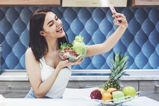 Young girl blogger photographs food and promotes healthy eating and veggie