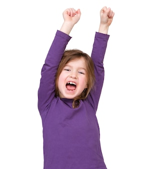 Young girl cheering with raised arms