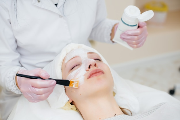 A young girl in a cosmetology office is undergoing facial skin rejuvenation procedures. cosmetology.
