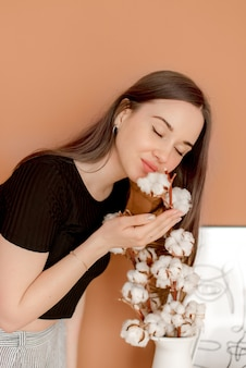 Young girl and cotton flowers