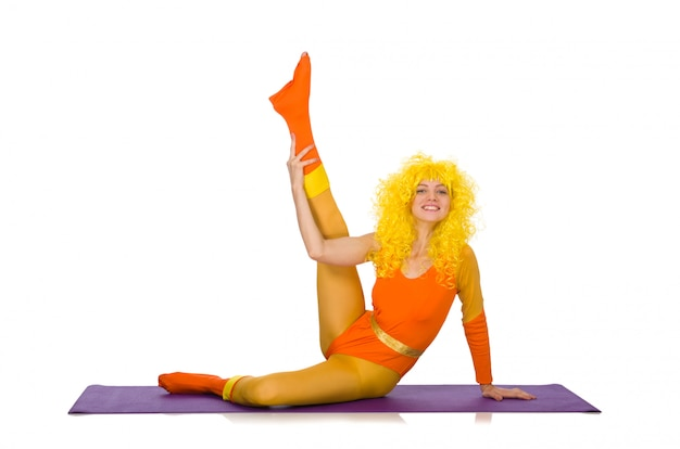 Young girl doing exercises on white