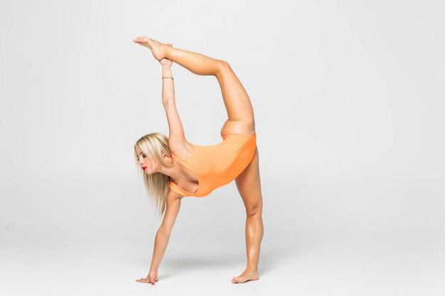 Young girl doing gymnastics exercise isolated