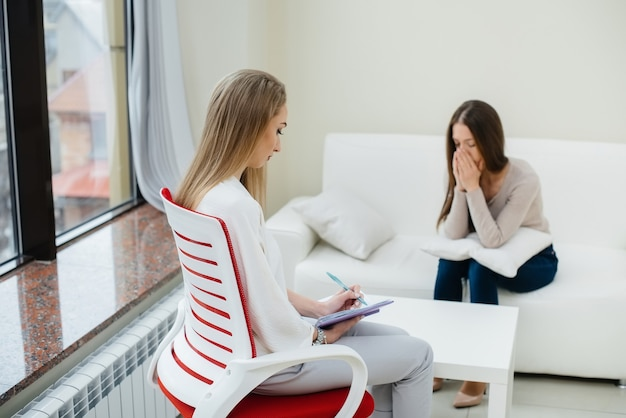 A young girl during depression communicates with a psychologist in the office
