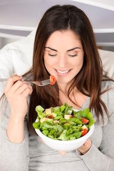 Young girl eating healthy food
