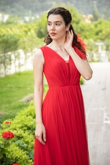 A young girl in an elegant red dress