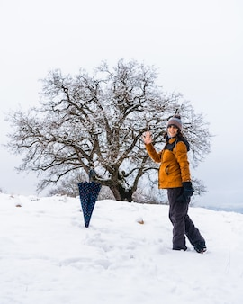 A young girl enjoying a lot in the winter in the snow. snow in the town of opakua near vitoria in araba