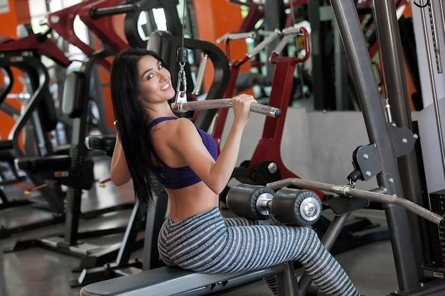 Young girl in the gym working out