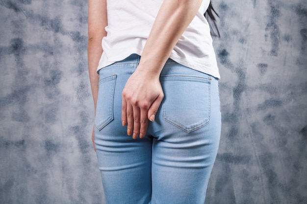 A young girl has hemorrhoids. health problems
