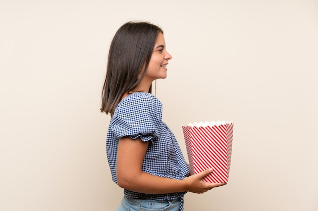 Young girl holding a bowl of popcorns