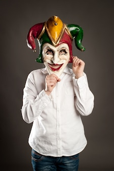 Young girl holding carnival mask