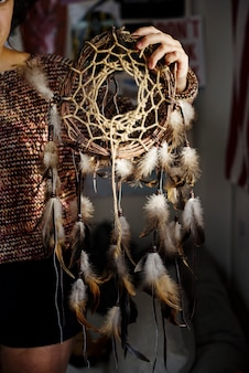 Young girl holding a diy dreamcatcher