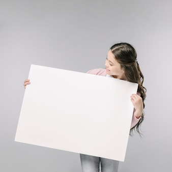 Young girl holding empty banner