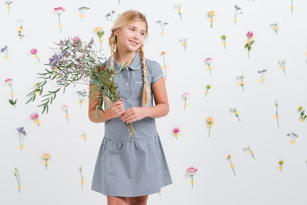 Young girl holding flowers bouquet