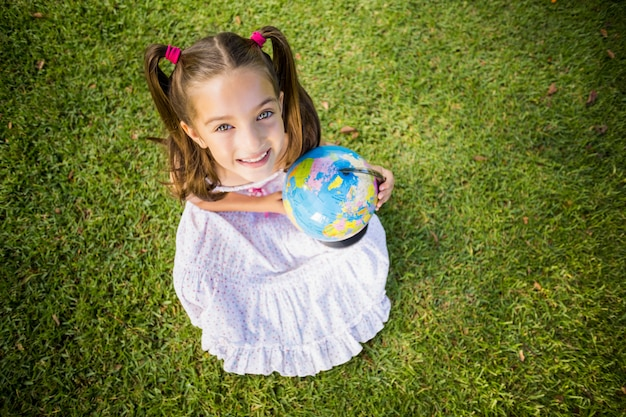 Young girl holding a globe