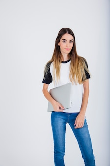 Young girl holding her lap top