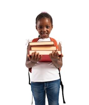 어린 소녀는 책을 보유하고 학교에 갈 준비가 프리미엄 사진