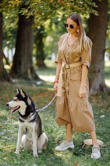 Young girl and husky
