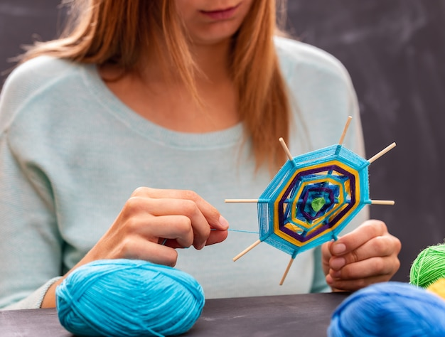 Young girl is doing handmade mandala