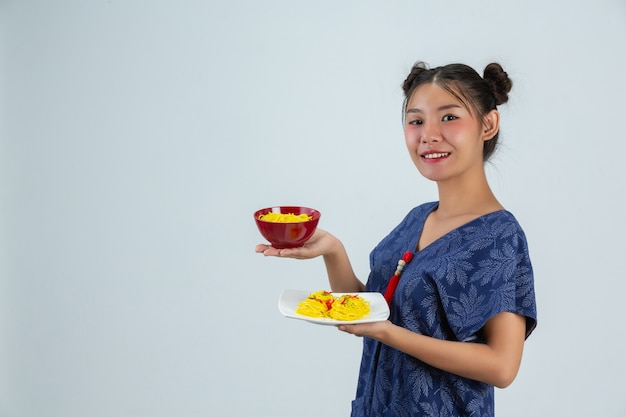 Young girl is enjoy eatting spaghetti at home