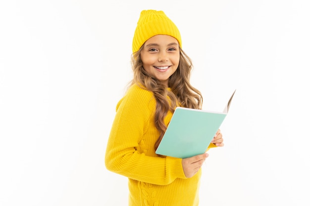 Young girl is reading a book on white with copyspace