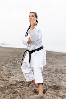 Young girl in karate costume training