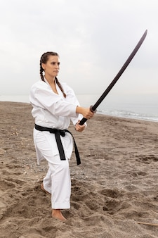 Young girl in karate outfit training