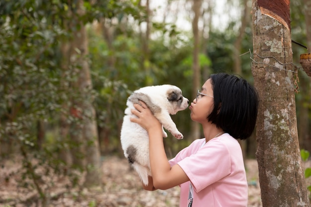 Young girl kiss puppy dog
