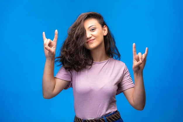 Young girl making peace symbol with fingers and enjoying the moment