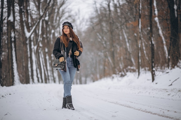 Young girl model walking in winter park