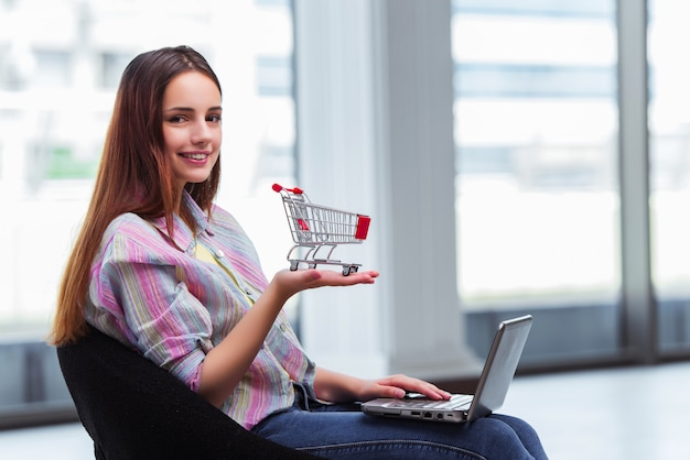 Young girl in online shopping concept