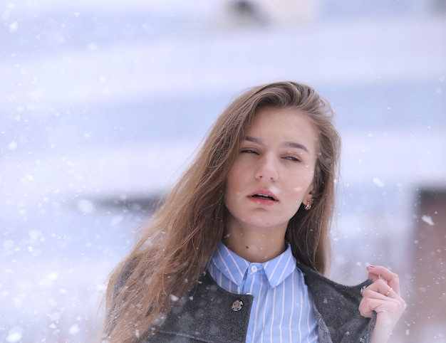Young girl outdoors in winter. model girl posing outdoors on a winter day. festive weekend in the street walking girl.