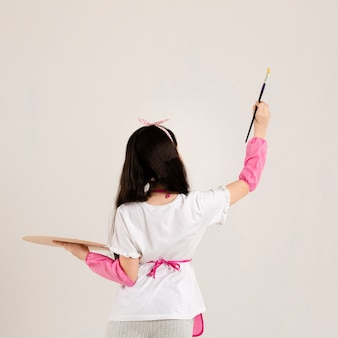 Young girl painting back view